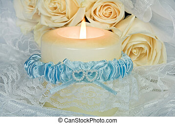 Blue Garter - Bride\'s garter wrapped around a candle.
