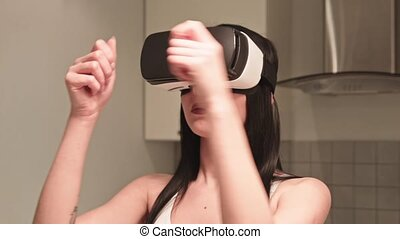 Brunette in headset VR giving product from furniture at...