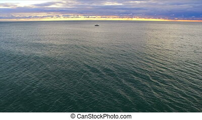 Drone flight over the sea pier with beacon and motorboat on...