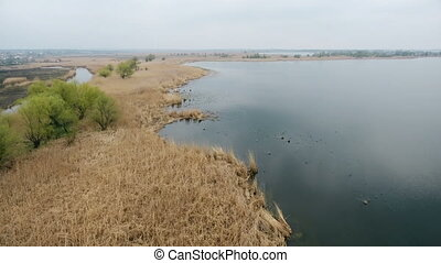 Aerial shot of the Dnipro river with rugged river bank and amazing horizon line