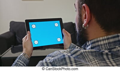 Man with a Digital Tablet with Blue Screen Motion