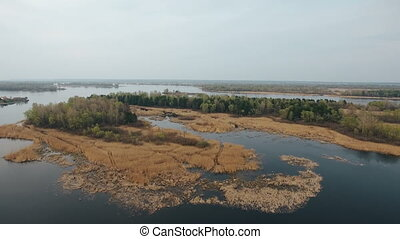 Aerial shot of small islets on the Dnipro river with cuvry...