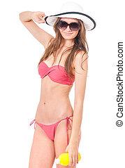 Girl posing in bikini - Sexy young woman posing in a pink...