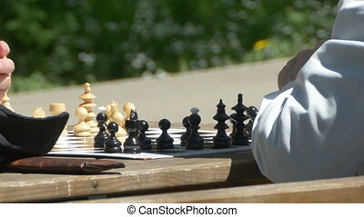 Hands Moving Chess Pieces - Chess players at the game table...