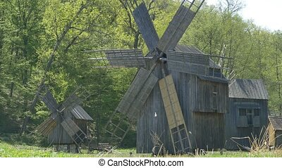 Wooden Vintage Windmills - Wooden old windmills in a rural...