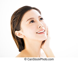 closeup   young  smiling woman face isolated on white