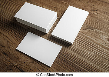 Photo of blank business cards on a wooden table background....
