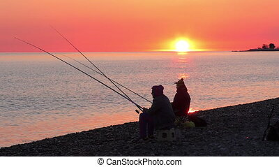 Beautiful scene with fisherman silhouette with rod sitting...