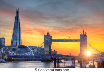 London tower Bridge with modern skyscrapers in sunset light
