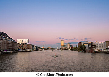 Berlin skyline - river spree panorama, boats and sunset sky...
