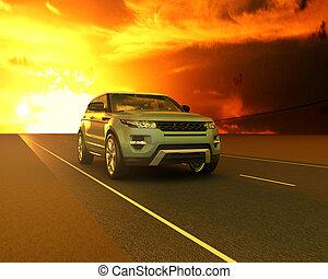 Blue Range rover against the sunset