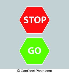 STOP AND GO SIGN ON GREY BACKGROUND