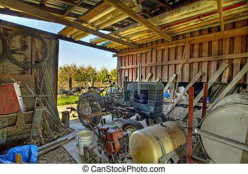 Farming Equipment in Red Barn Shed on Oregon Farmland