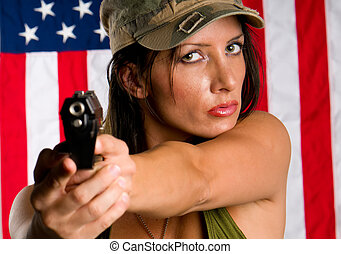Armed woman - Young woman wearing military uniform pointing...