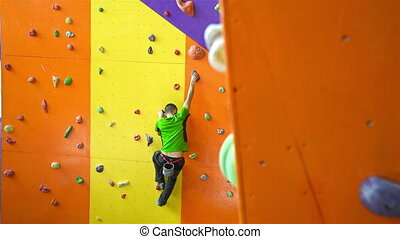 Man Climbing Up On Practice Wall - Young Man Climbing Up On...