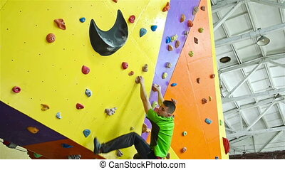 Climber Man On Artificial Climbing Wall In Bouldering Gym