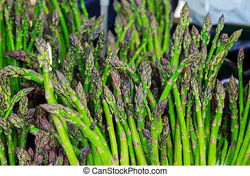 farmer's market selling Fresh asparagus - farmer's market...