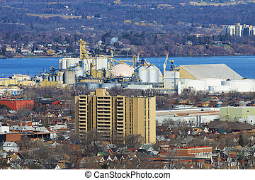 The Hamilton industrial area with harbour in background -...