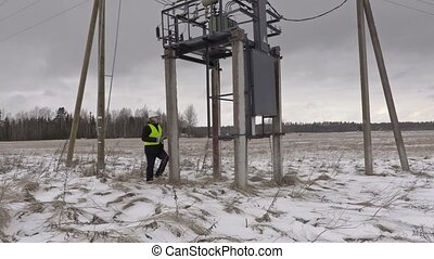 Electrician take pictures under  power lines