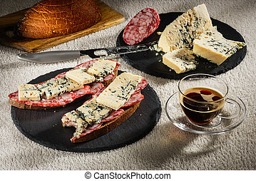 Two sandwiches from black bread with cheese of Dorblu and...