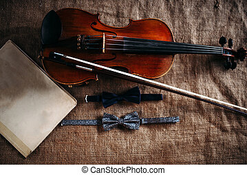 Violin, fiddlestick, notes and bowties closeup - Violin,...
