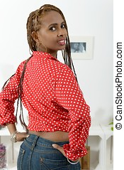 Beautiful young african american woman with braids