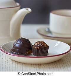 Chocolate petit fours - Chocolate petit four, cup and kettle...