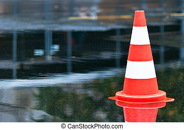 Cone in a puddle V2 - warning cone in a puddle at the street