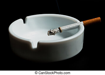 V3 cigarette in the ashtray - burning cigarette in the...