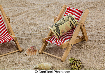 deckchair with piggy bank and dollars - deckchair with...
