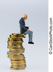 pensioners sitting on a pile of money, symbol photo for...