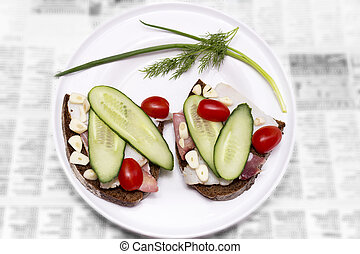 Plate with sliced lard, bread, tomates, cucumber and garlic....