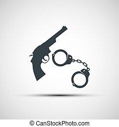 Gun and handcuffs. - Gun and handcuffs on a white...
