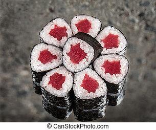Mini roll with tuna over concrete background