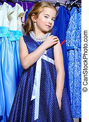 enjoy shopping day - Pretty little girl child choosing a new...