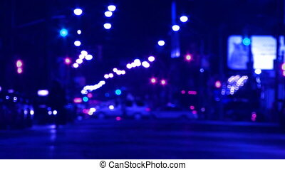 Blue city at night - Defocused downtown shot of city at...
