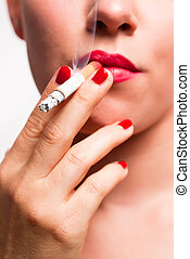 mouth with red lips and red finger nails smoking cigarette...