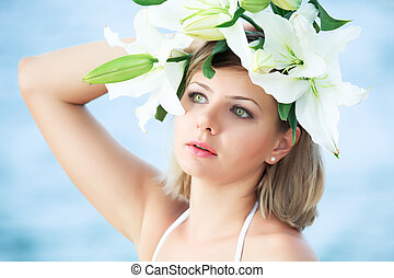 Woman in wreath - Portrait of a young beautiful woman in...