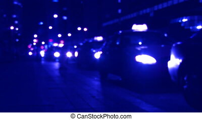 Late night taxi stand. Defocused. - Defocused downtown...