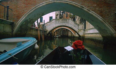 View from a gondola in canal - View from a gondola as it...