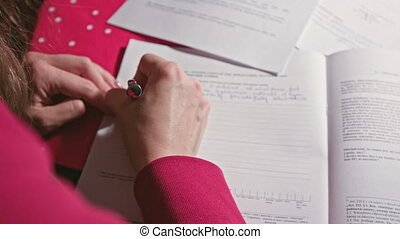 Woman Writing or Signing in a Document - Woman hand writing...