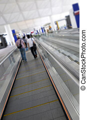 Airport travelator with people in the distance. Please note...