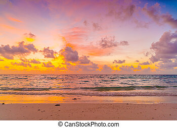 Beautiful sunset with sky over calm sea in tropical Maldives...