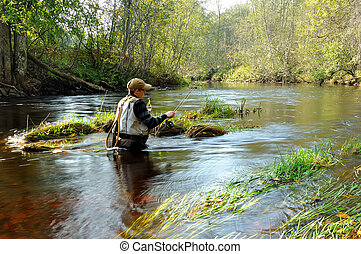 Fly-fisher who catching a trout