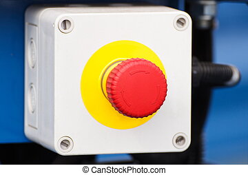 Emergency stop button on industrial machine, safety at work
