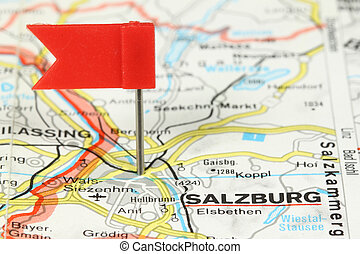 Salzburg - famous city in Austria, Europe. Red flag pin on...