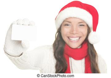 Christmas girl showing business card sign - Christmas woman...