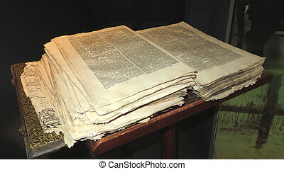 Old Bible with loose sheets by frequent use