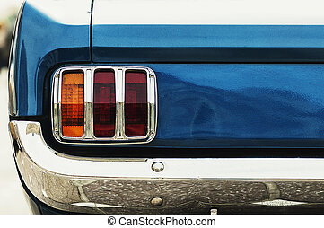 Closeup on the taillight of an old retro car. Back light and...