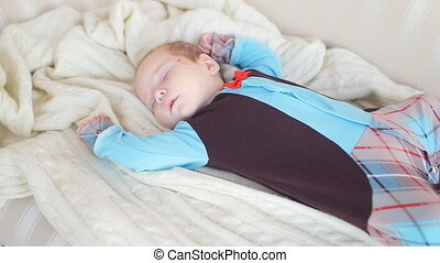 Peaceful baby lying on a bed while sleeping - Baby lying on...
